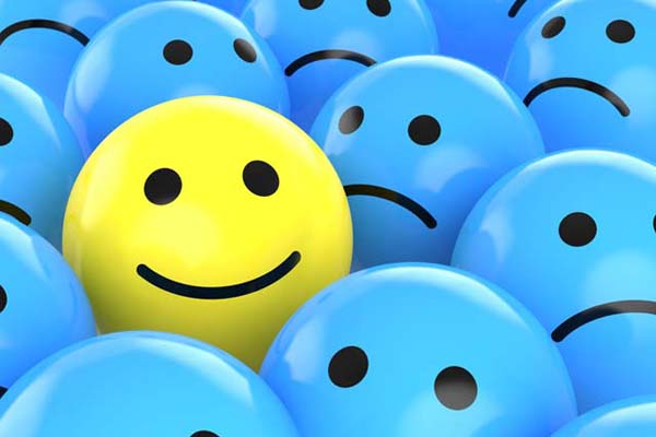 yellow-happy-face-ball-among-blue-sad-face-balls